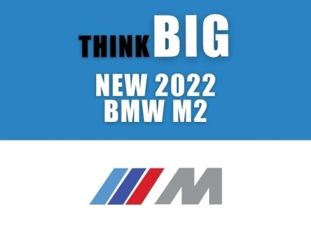 "Big Motoring World 'think big' logo above ""new 2022 BMW M2 "" with the BMW M Sport logo beneath"