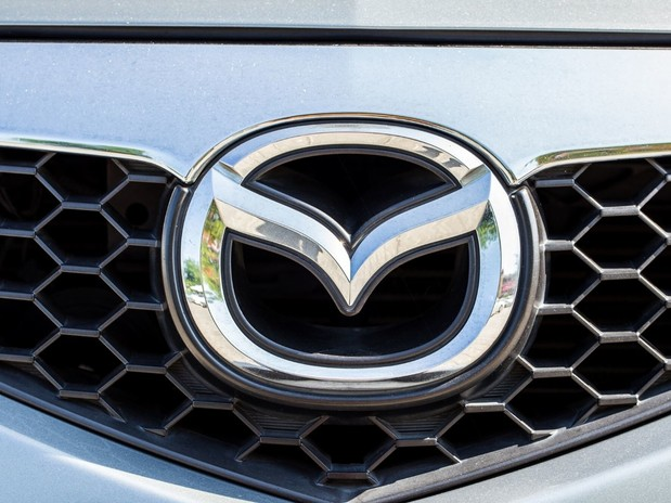 The Mazda logo emblem on a silver Mazda