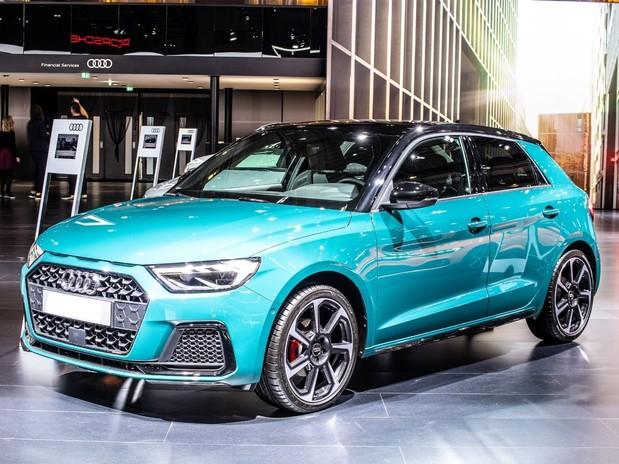 A turquoise 2020 Audi A1 Sportback inside of a showroom