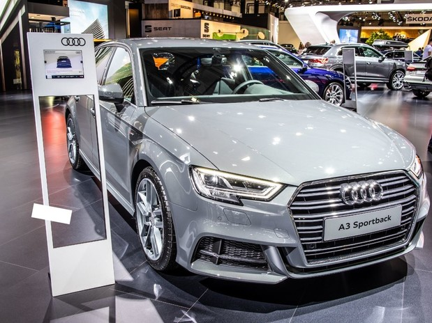 A light grey, 2020 Audi A3 in a showroom (front three-quarter view)