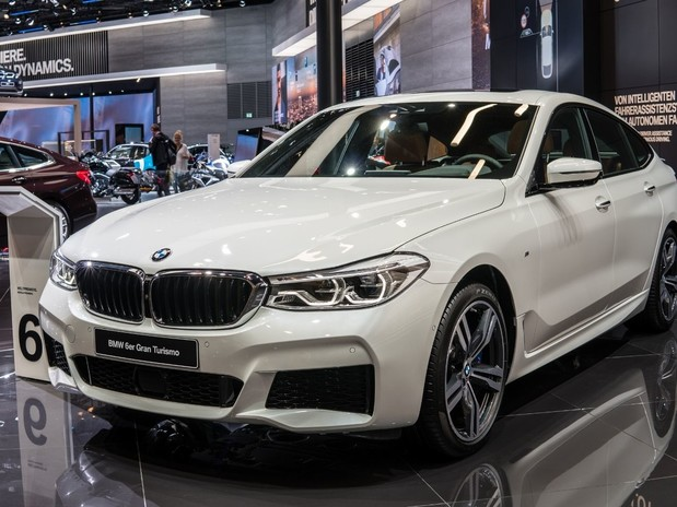 A white, 2017 BMW 6 Series in a showroom