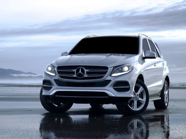 A Mercedes-Benz GLE in white on the ocean shore.