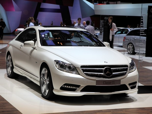 The Mercedes CL Class in white at a motor show in Geneva