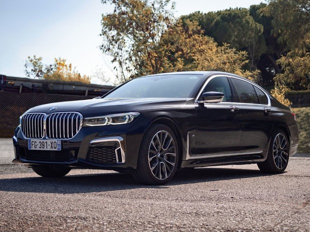 A black BMW 730i M Sport on some concrete in Montmelo, Spain