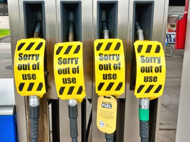 """4 petrol pumps with a """"sorry out of use"""" sign on them all"""